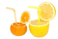 Jugo de fruta abstracto del limón y del mandarín. Fotos de archivo