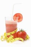 Jugo de tomate con la cinta de medición Fotografía de archivo libre de regalías
