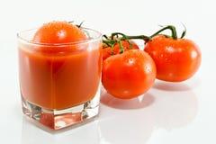 Jugo de tomate y tomate Imagen de archivo