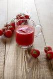 Jugo de tomates Imagenes de archivo