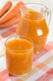 Jugo de zanahoria Foto de archivo libre de regalías
