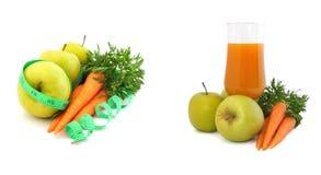 Jugo de zanahoria con las manzanas y las zanahorias Imagenes de archivo