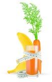 Jugo de zanahoria del plátano con el metro Foto de archivo libre de regalías
