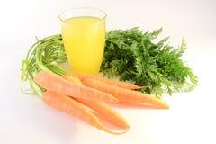 Jugo de zanahorias Imagen de archivo libre de regalías
