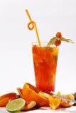 Jugo fresco anaranjado con la fruta de la pasión Imágenes de archivo libres de regalías