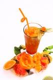Jugo fresco anaranjado con la fruta de la pasión Fotografía de archivo libre de regalías