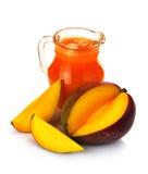 Jugo y fruta del mango Imagen de archivo