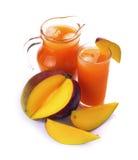 Jugo y fruta del mango Fotos de archivo libres de regalías
