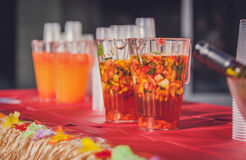 Jugs of alcohol punch. Jugs containing alcoholic fresh fruit punch to be served for guests Stock Photo