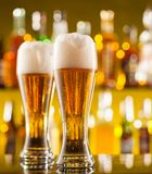 Jugs of beer served on bar counter Royalty Free Stock Photography