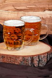 Jugs of blonde beer Royalty Free Stock Photography