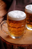 Jugs of blonde beer Royalty Free Stock Images