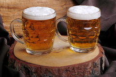 Jugs of blonde beer Stock Photography