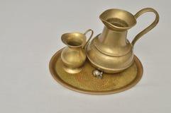 Jugs. Brass jugs on a brass tray Stock Photo