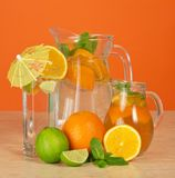 Jugs with drinks and glass Stock Photo
