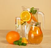 Jugs with drinks and glass Stock Image