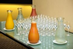 Jugs of fresh fruit juice on a table for breakfast royalty free stock images