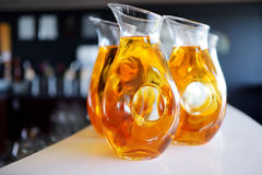 Jugs full of refreshing drink on festive event Royalty Free Stock Images
