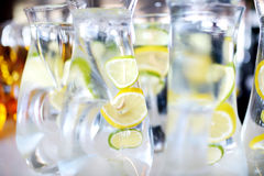 Jugs full of refreshing lime drink Stock Images