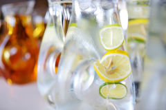 Jugs full of refreshing lime drink on some festive event Royalty Free Stock Images