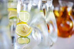 Jugs full of refreshing lime drink on some festive event Stock Photos