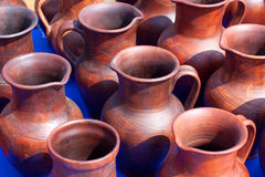 Jugs on market. National culture ceramic handmade brown jugs on market Stock Image