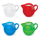 Jugs with milk Royalty Free Stock Image