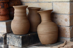 Jugs before roasting. On the furnace for roasting there are three clay jugs Stock Photo