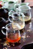 Jugs of tea. Jugs contain various types of tea Royalty Free Stock Photos