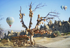 Jugs on a tree and old wagon full of clay pots Royalty Free Stock Photography
