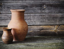 Jugs on wooden background. Two jugs on wooden background Royalty Free Stock Photography