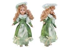 Juguete aislado de la muñeca en vestido y sombrero verdes Foto de archivo libre de regalías