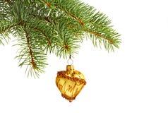 Juguete amarillo de la Navidad en árbol de abeto Imágenes de archivo libres de regalías