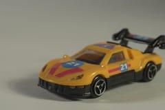 Juguete amarillo viejo del coche Foto de archivo libre de regalías