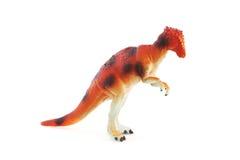 Juguete anaranjado del dinosaurio fotografía de archivo libre de regalías