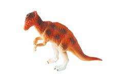 Juguete anaranjado del dinosaurio imagenes de archivo