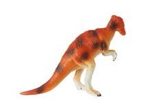 Juguete anaranjado del dinosaurio, aislado fotos de archivo