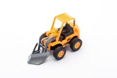 Juguete anaranjado del tractor fotografía de archivo
