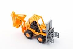 Juguete anaranjado del tractor imagenes de archivo
