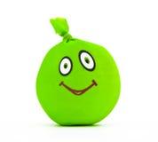 Juguete bajo la forma de sonrisa verde Fotos de archivo libres de regalías