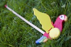 Juguete coloreado en la hierba Imagen de archivo