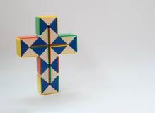Juguete de la torsión del crucifijo Fotografía de archivo