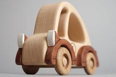 Juguete de los niños, un coche de madera viejo Imágenes de archivo libres de regalías