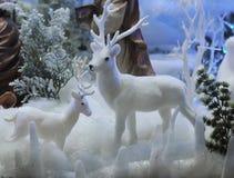 Juguete de los renos de la Navidad en la nieve Fotografía de archivo libre de regalías