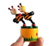 Juguete de madera las abejas del baile Imagen de archivo