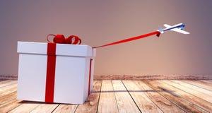 Juguete del aeroplano que tira del regalo de Navidad blanco enorme Foto de archivo