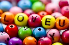 Juguete del alfabeto de Colorfull con un amor U de la palabra en él Imagen de archivo libre de regalías