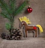 Juguete del caballo en la Navidad Foto de archivo libre de regalías