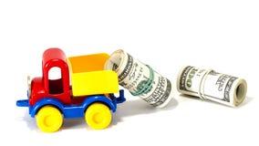 Juguete del camión en el camino del dinero Fotografía de archivo