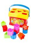 Juguete del clasificador de la forma con los diversos bloques coloreados aislados Fotografía de archivo